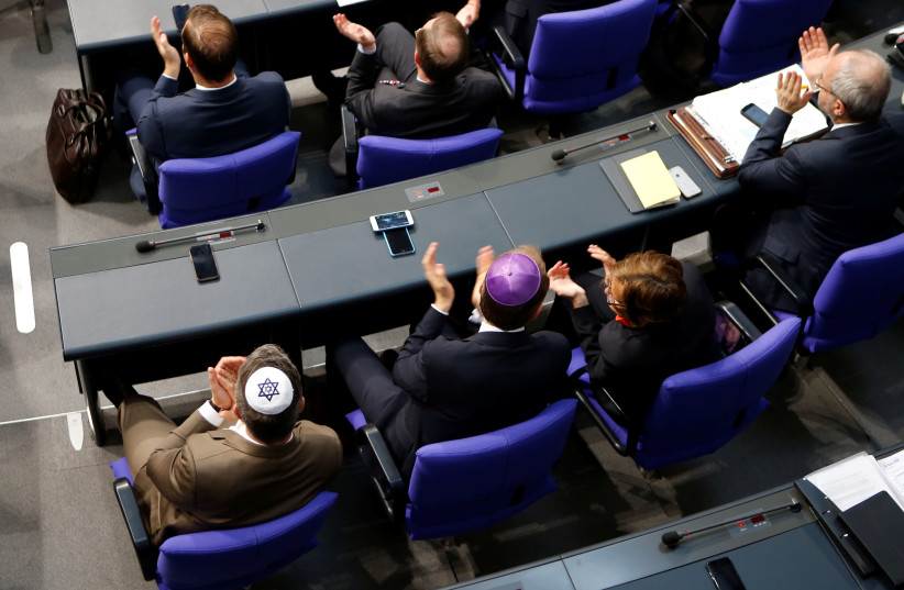 Members of the German parliament wearing kippas attend a session of the Bundestag in Berlin (photo credit: AXEL SCHMIDT/REUTERS)
