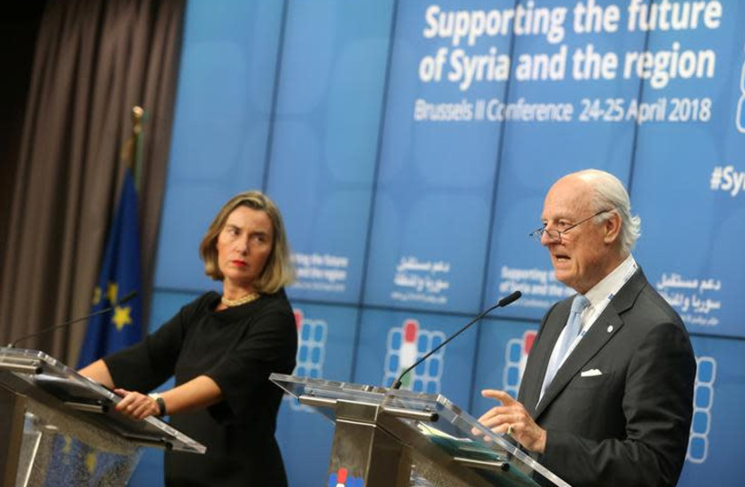 European Union foreign policy chief Federica Mogherini and United Nations Special Envoy for Syria Staffan de Mistura address a news conference during an international conference on the future of Syria and the region, in Brussels, Belgium, April 25, 2018.  (photo credit: REUTERS/FRANCOIS WALSCHAERTS)