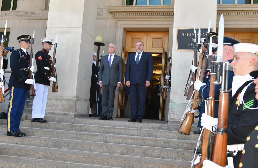 United States Secretary of Defense James Mattis (L) poses for a photo with Defense Minister Avigdor Liberman (R), April 26th, 2018.  (photo credit: DEFENSE MINISTRY/ARIEL HERMONI)