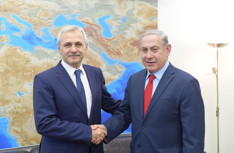 Prime Minister Benjamin Netanyahu (R) shakes hands with Romanian President of the Chamber of Deputies Liviu Dragnea (L) during the latter's visit to Jerusalem, April 26th, 2018. (photo credit: AMOS BEN-GERSHOM/GPO)