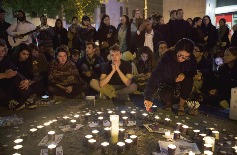 PEOPLE TAKE PART in a memorial in the capital's Zion Square last night for the 10 teenagers who died in the Tzafit canyon disaster last week. (photo credit: YONATAN SINDEL/FLASH 90)