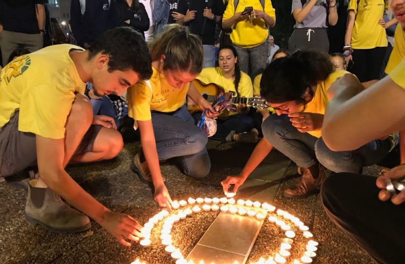 Dozens of teenagers gathering in circles Tel Aviv's Rabin Square, in memory of those killed in the Tzafit canyon flood disaster. (photo credit: AVSHALOM SASSONI/ MAARIV)
