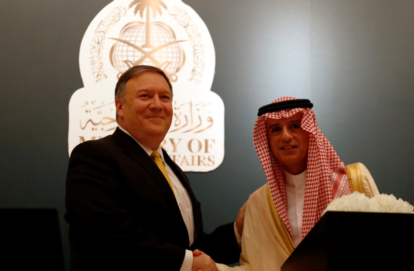 U.S. Secretary of State Mike Pompeo shakes hands with his Saudi counterpart Adel al-Jubeir during a news conference, in Riyadh, Saudi Arabia April 29, 2018. (photo credit: FAISAL AL NASSER/ REUTERS)