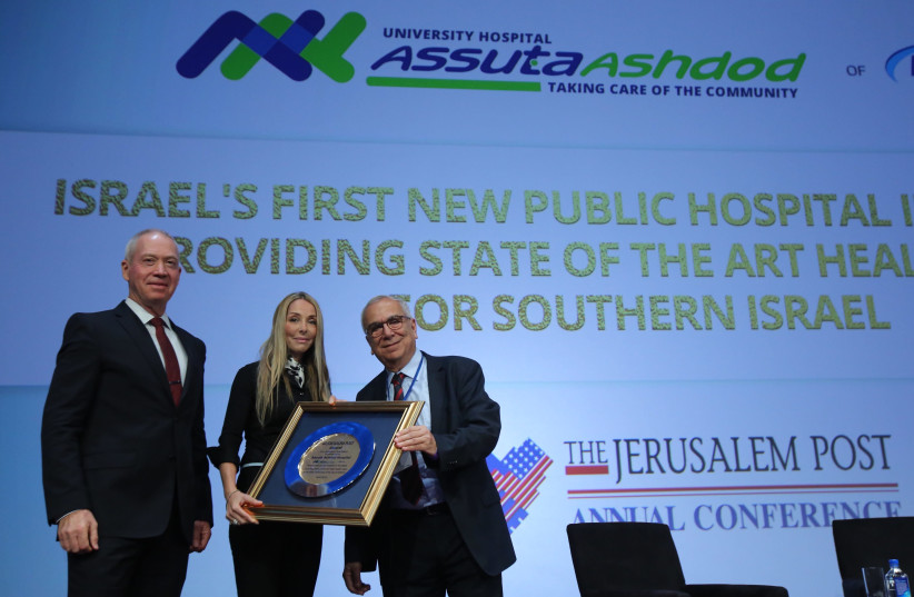 Prof. Joshua (Shuki) Shemer, MD, Chairman of the Board of Directors, Assuta Medical Centers Network receiving Assuta Prize by Minister of Construction Yoav Gallant and Jerusalem Post Group CEO Ronit Hassin-Hochman at the 7th Annual JPost Conference in NY (photo credit: MARC ISRAEL SELLEM)