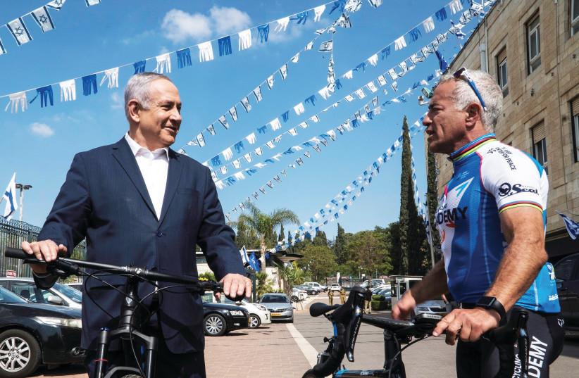 Israel Cycling Academy co-owner Sylvan Adams (right, with Prime Minister Benjamin Netanyahu) (photo credit: SHAHAR TZARFATI)