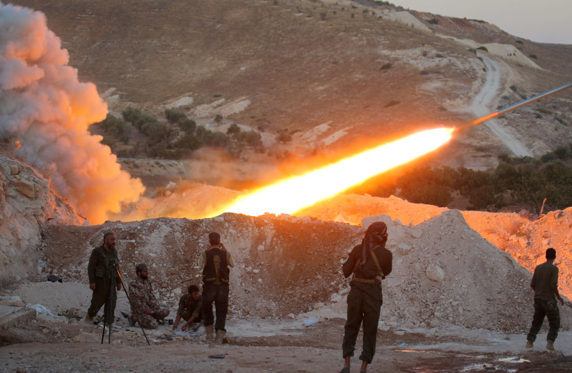Free Syrian Army fighters launch a Grad rocket from Halfaya town in Hama province, towards forces loyal to Syria's President Bashar Assad stationed in Zein al-Abidin mountain, Syria September 4, 2016.  (photo credit: REUTERS/AMMAR ABDULLAH/FILE PHOTO)