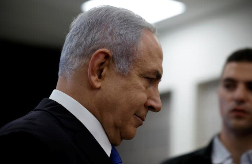 Israeli Prime minister Benjamin Netanyahu leaves the room after a news conference at the Ministry of Defence in Tel Aviv, Israel, April 30, 2018 (photo credit: REUTERS/AMIR COHEN)