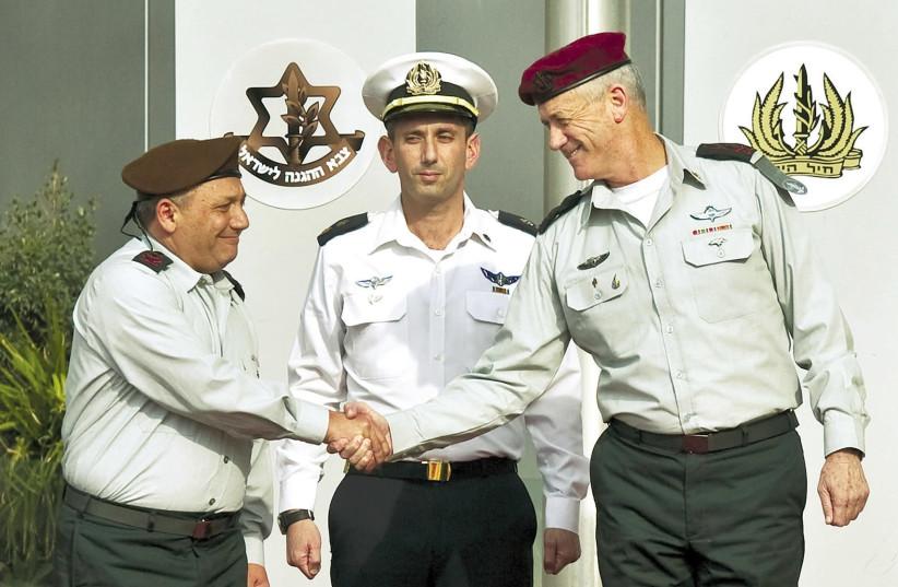 IDF Chief of Staff Lt.-Gen. Gadi Eisenkot (left) shakes hands with Lt.-Gen. Benny Gantz at the IDF headquarters in Tel Aviv in 2015  (photo credit: NIR ELIAS / REUTERS)