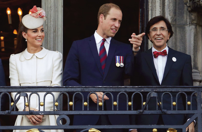 Britain's Prince William (center) and his wife, Kate, appear on a balcony at the Mons Town Hall with Belgian outgoing prime minister Elio Di Rupo in 2014 (photo credit: YVES HERMAN / REUTERS)