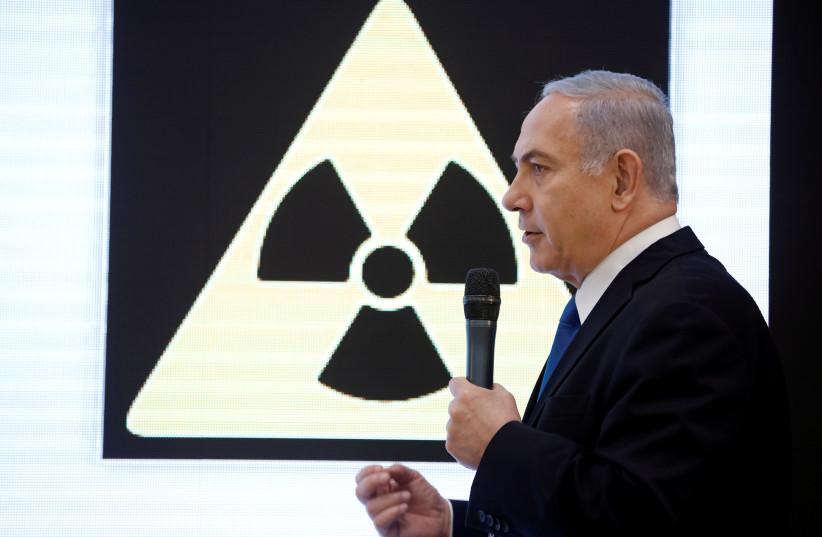 Israeli Prime minister Benjamin Netanyahu speaks during a news conference at the Ministry of Defense in Tel Aviv, Israel, April 30, 2018 (photo credit: AMIR COHEN/REUTERS)