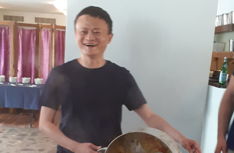 Alibaba chairman Jack Ma cooks up a batch of Mafrum while on a visit in Israel (photo credit: EUCALYPTUS RESTAURANT)
