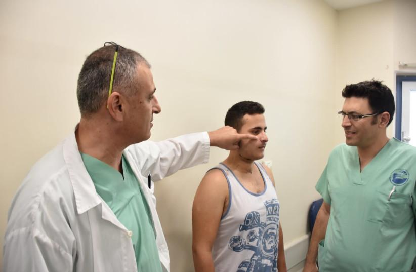 Dr. Abu Jabel and Dr. Abu El-Naaj helped reconstruct Alkish Nijad's jaw bone from a leg bone (photo credit: PORIYA HOSPITAL)