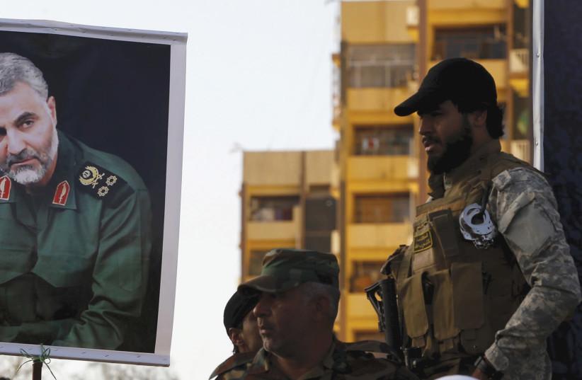 A POSTER of Iranian Quds Force leader Qassem Suleimani. (photo credit: REUTERS)