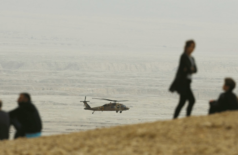 A HELICOPTER searches for hikers who died in a flash flood. (photo credit: REUTERS)
