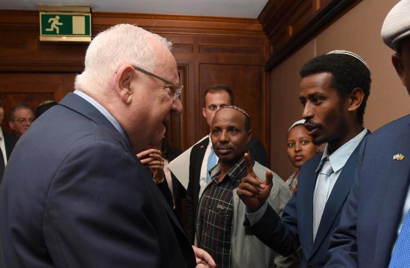 President Rivlin with Falash Mura visitors  (photo credit: MARC NEYMAN/GPO)