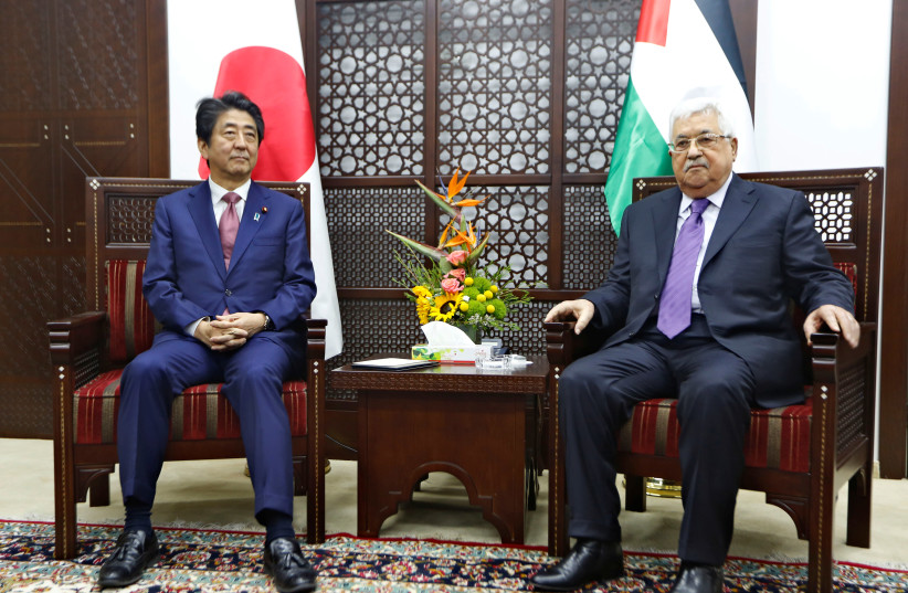 Palestinian President Mahmoud Abbas meets with Japan's Prime Minister Shinzo Abe in Ramallah (photo credit: REUTERS)