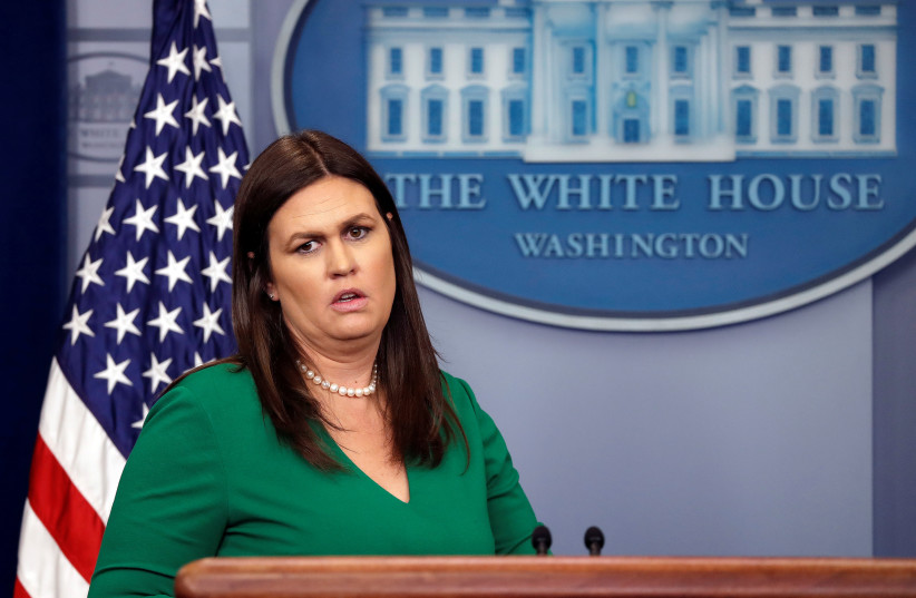 U.S. White House Press Secretary Sarah Huckabee Sanders holds the daily briefing at the White House in Washington, DC, U.S., April 9, 2018. (photo credit: CARLOS BARRIA / REUTERS)