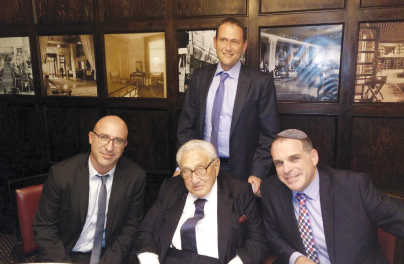 ODED REVIVI PAUSES for a photo during a meeting with former US secretary of state Henry Kissinger and Itai Ofir, legal counsel for security systems with the Defense Ministry (photo credit: ODED RAVIVI)