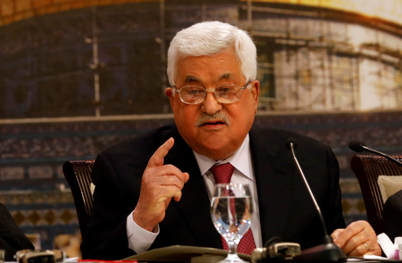 Palestinian President Mahmoud Abbas gestures as he speaks during the Palestinian National Council meeting in Ramallah (photo credit: MOHAMAD TOROKMAN/REUTERS)