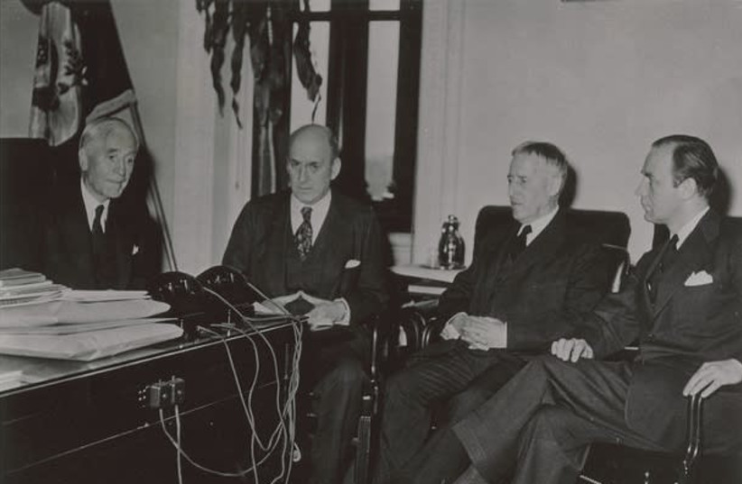 Third meetings of the Board of Directors of the War Refugee Board in the office of Secretary of State Cordell Hull. Pictured from left to right are: Cordell Hull, Henry Morgenthau, Henry L. Stimson, and John Pehle, Executive Director, March 21, 1944  (photo credit: VIA UNITED STATES HOLOCAUST MEMORIAL MUSEUM (COURTESY FRANKLIN D ROOSEVELT LIBRARY))