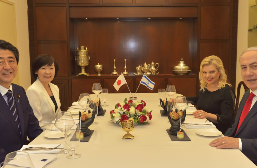 JAPAN'S PRIME MINISTER Shinzo Abe and his wife, Akie, sit down with Prime Minister Benjamin Netanyahu and his wife, Sara, in Jerusalem yesterday. (photo credit: KOBI GIDEON/GPO)