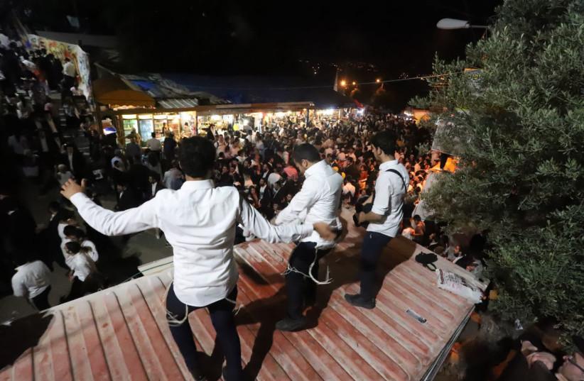 Thousands celebrate Lag BaOmer in the northern Israeli city of Meron (photo credit: EITAN ELHADAZ/TPS)