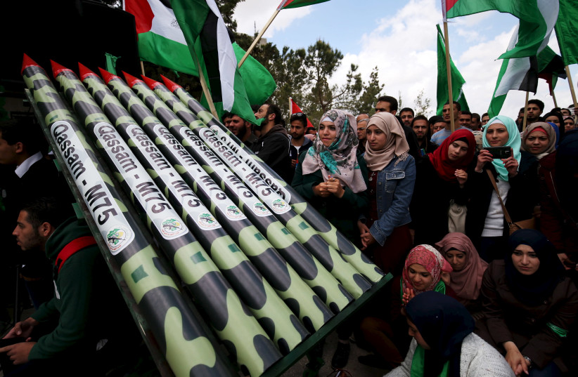Palestinian students supporting Hamas stand next to mock Hamas rockets during a rally celebrating their winning of the student council election at Birzeit University in the West Bank city of Ramallah April 23, 2015. (photo credit: REUTERS/MOHAMAD TOROKMAN)
