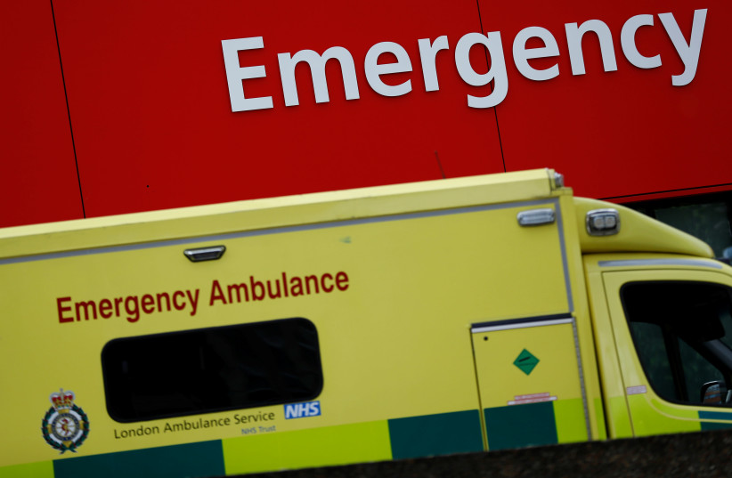An ambulance waits outside the emergency department in London, Britain (photo credit: STEFAN WERMUTH/REUTERS)