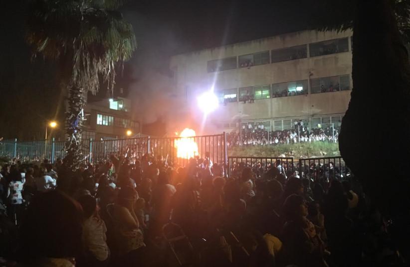 Bnei Brak residents gather around a bonfire, singing songs in honor of the sage Rabbi Shimon Bar Yochai, May 2, 2018. (photo credit: AVRAHAM GOLD)