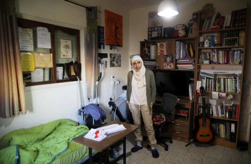 Arab-Israeli poet Dareen Tatour poses for a picture during an interview at her house in Reineh, northern Israel September 26, 2017. Picture taken September 26, 2017. (photo credit: AMMAR AWAD/REUTERS)