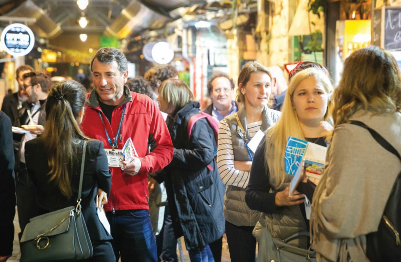 Visiting venture capitalists mingle and network in Jerusalem's Mahaneh Yehuda market last week, as part of an annual Kauffman Fellows summit showcasing tech in the capital (photo credit: Courtesy)