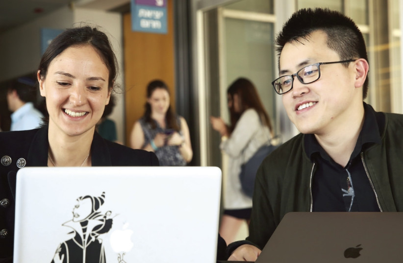 SOFAER MBA students Tamar Pruidze and Shuang Qiu in conversation. (photo credit: Courtesy)
