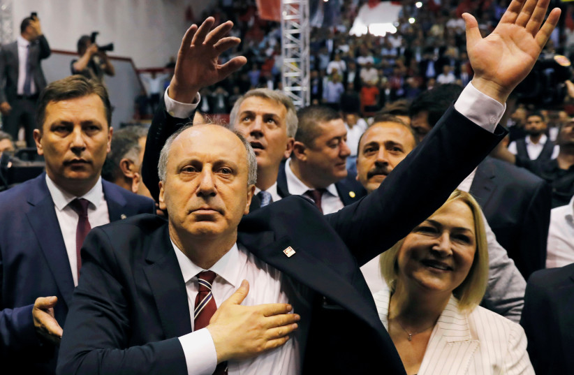 Muharrem Ince, Turkey's main opposition Republican People's Party (CHP) candidate for the upcoming snap presidential election, and his wife Ulku arrive for a party gathering in Ankara, Turkey, May 4, 2018. (photo credit: REUTERS/UMIT BEKTAS)