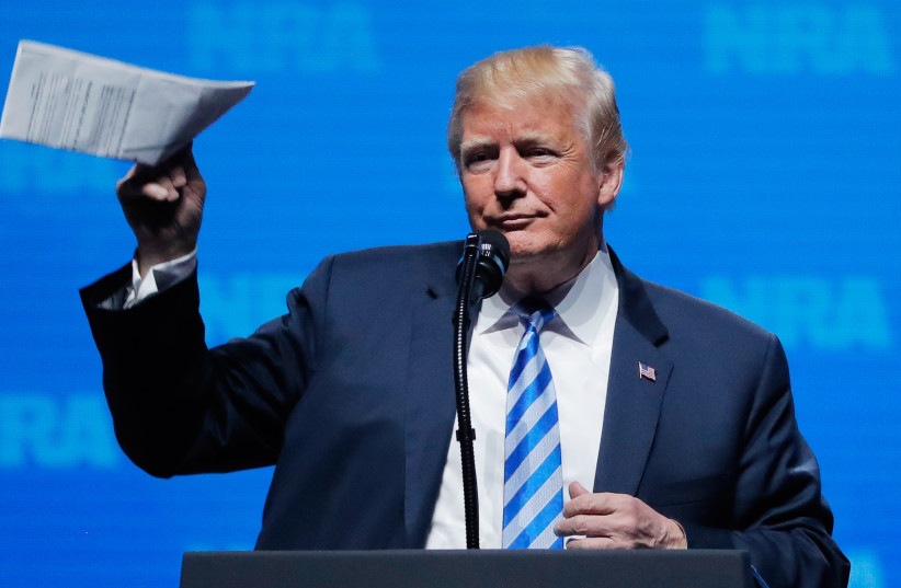 U.S. President Donald Trump gestures before he speaks at a National Rifle Association (NRA) convention in Dallas (photo credit: LUCAS JACKSON / REUTERS)