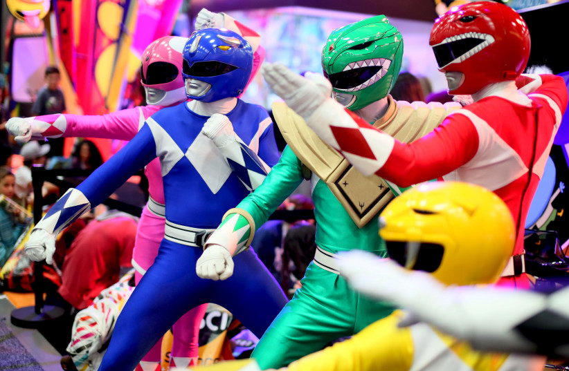A group of Power Rangers pose inside the Convention Center at the 2015 Comic-Con International in San Diego, California July 9, 2015 (photo credit: REUTERS/SANDY HUFFAKER)