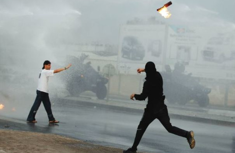 PROTESTERS CLASH with police in Bahrain during 2011 Arab Spring protests (photo credit: REUTERS)