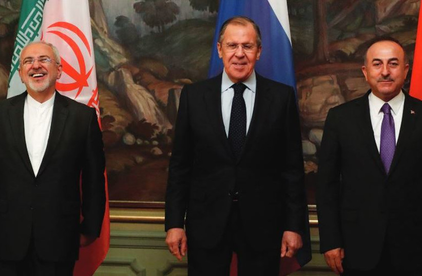 Foreign Ministers Mohammad Javad Zarif of Iran, Sergei Lavrov of Russia and Mevlut Cavusoglu of Turkey (photo credit: REUTERS)