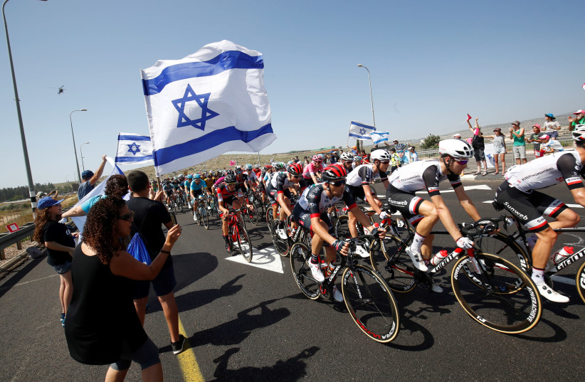 Israeli fans cheer for the riders during the 2nd stage of the 101st Giro d'Italia, Tour of Italy, on May 5, 2018, 167 kilometers between Haifa and Tel Aviv.  (photo credit: LUK BENIES / AFP)