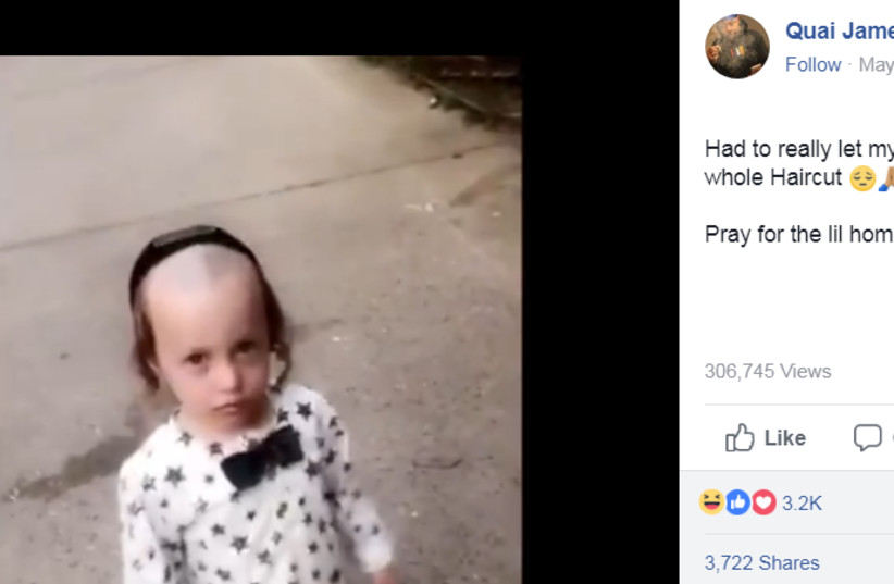 A screenshot from a viral video of man berating a young hassidic boy (photo credit: FACEBOOK SCREENSHOT)