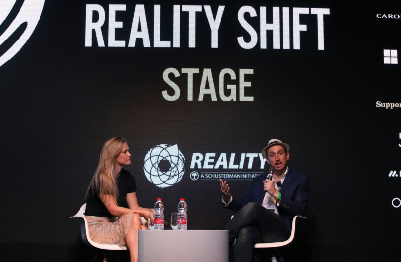 Supermodel Bar Rafaeli and Randall Lane, Chief Content Officer at Forbes Magazine at the Forbes Under 30 Summit Global  (photo credit: SASSON TIRAM)