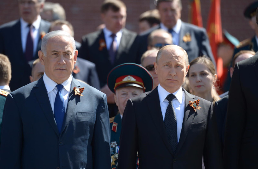 Prime Minister Benjamin Netanyahu and Russian President Vladimir Putin at the Victory Day parade in Moscow, May 2018 (photo credit: PMO)