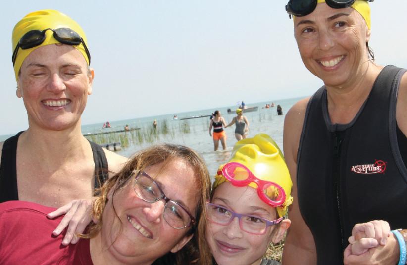 Participants at the Swim4Sadna (photo credit: LAURA BEN-DAVID)