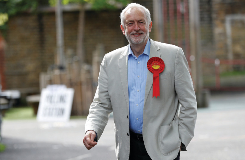 BRITISH LABOUR Party leader Jeremy Corbyn arrives to vote in local government elections in London on May 3 (photo credit: REUTERS)