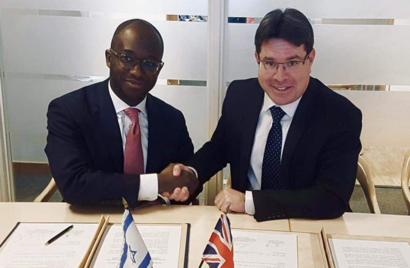 Science and Technology Minister Ofir Akunis (R) meets with UK Minister of State for Universities and Science Sam Gyimah (L), February 2018. (photo credit: Courtesy)