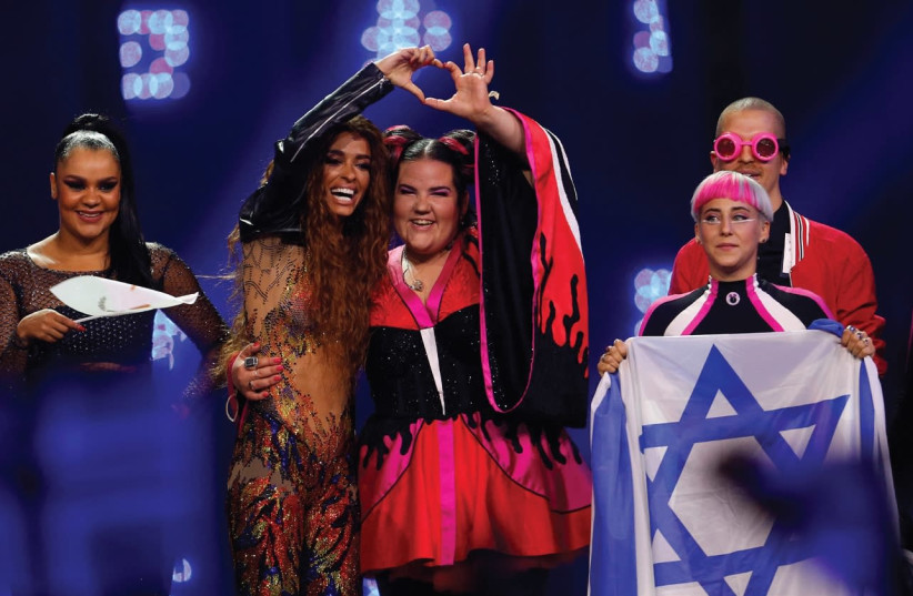 CYPRUS'S ELENI FOUREIRA and Israel's Netta react after the semi-finals for the Eurovision Song Contest 2018 in Lisbon, Portugal, Tuesday. (photo credit: PEDRO NUNES/REUTERS)