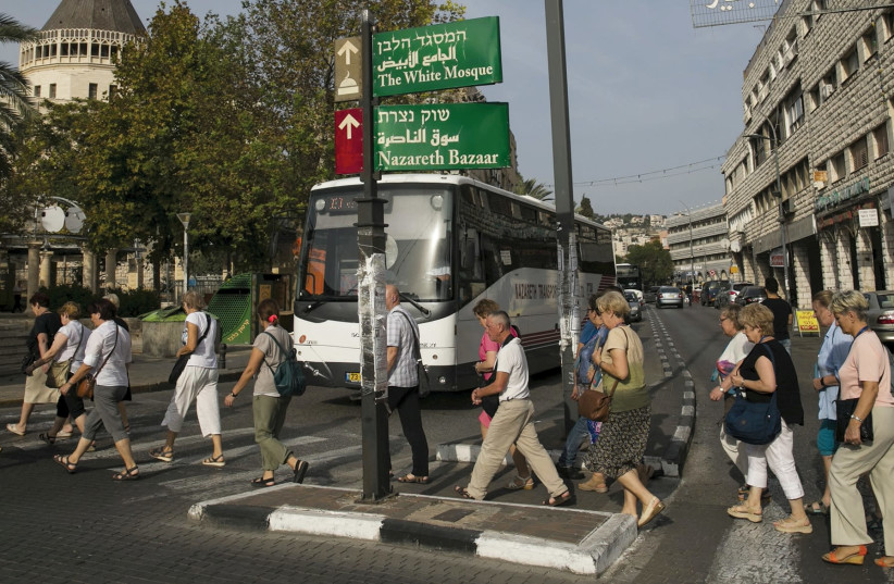 People walking in Nazareth  (photo credit: REUTERS)