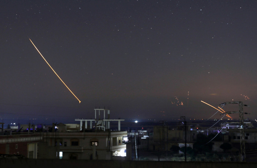 Missile fire is seen over Daraa, Syria, May 10, 2018 (photo credit: ALAA AL-FAKIR / REUTERS)