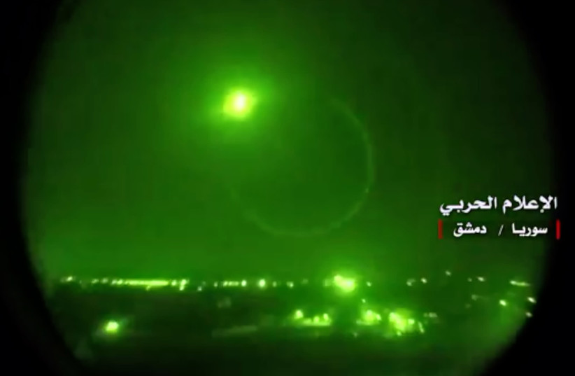 """An image grab from a video released on May 10, 2018 by the """"Central War Media"""" and broadcast on Syria's official TV purportedly shows Syrian air defense systems intercepting Israeli missiles over Syrian airspace (photo credit: AFP PHOTO / HO / CENTRAL WAR MEDIA)"""