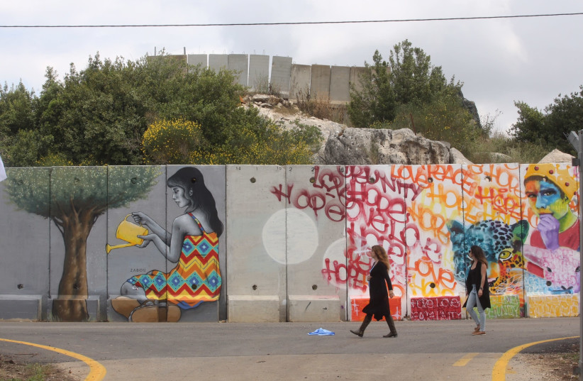 A dozen artists from around the world descended on the community of Shtula on Israel's northern border to paint the security fence with Lebanon (photo credit: MARC ISRAEL SELLEM)