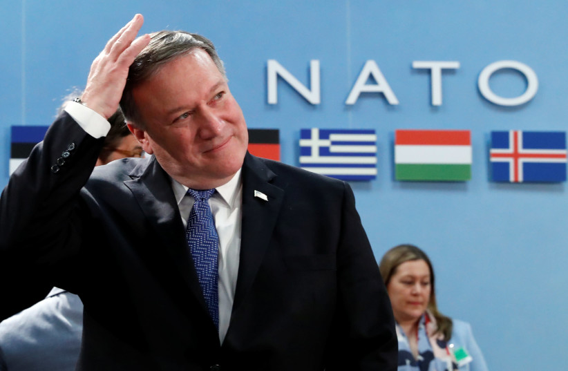 US Secretary of State Mike Pompeo attends a NATO foreign ministers meeting at the Alliance's headquarters in Brussels (photo credit: YVES HERMAN/REUTERS)
